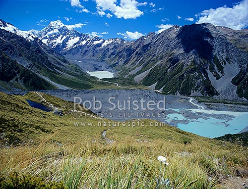Mount Cook Aoraki (3754m) in head of the Hooker Valley viewed from above Sealy Tarns. Mueller Glacier morraine centre, and terminal lake and Mt Wakefield (2012m) at right, Aoraki / Mount Cook National Park, MacKenzie District, Canterbury Region, New Zealand (NZ) stock photo.