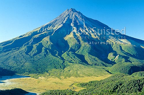 Mount (Mt) Egmont/Taranaki (2518m) viewed from the Pouakai Range. Ahukawakawa Swamp below, Egmont National Park, Taranaki, New Plymouth District, Taranaki Region, New Zealand (NZ) stock photo.
