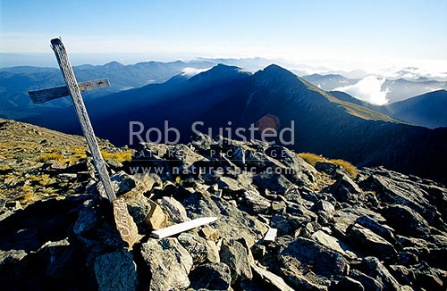 Looking NE from Mount (Mt) Richmond (1755m) past Mount (Mt) Fell (1599m) towards the Marlborough Sounds in distance. Memorial wooden cross in the foreground, Mount Richmond Forest Park, Marlborough District, Marlborough Region, New Zealand (NZ) stock photo.