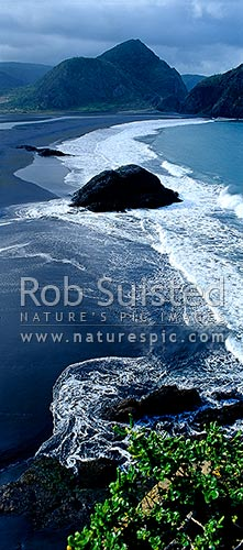 Surf rolling onto Whatipu Beach (black ironsand) at the entrance to Manukau harbour, Auckland, Waitakere City District, Auckland Region, New Zealand (NZ) stock photo.