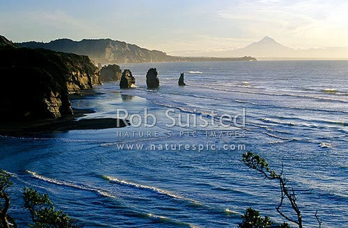 Looking south from Tongaporutu, past the '3 Sisters rocks' towards Mount (Mt) Taranaki, North Taranaki, New Plymouth District, Taranaki Region, New Zealand (NZ) stock photo.