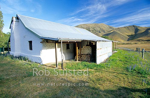 Historic cobb constructed Acheron Accommodation house by the Clarence River; Molesworth Station, Marlborough, Marlborough District, Marlborough Region, New Zealand (NZ) stock photo.