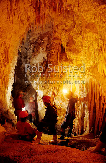 A group of cavers in the Catherwoods cave. Limestone formations, Waitomo, Waitomo District, Waikato Region, New Zealand (NZ) stock photo.