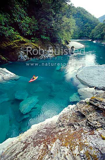 Kayaking in Tomtit Grotto. Haast River, South Westland, Westland District, West Coast Region, New Zealand (NZ) stock photo.