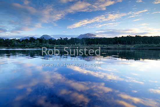 Beautiful cloud reflections on Hapuka Estuary, Okuru Lagoon, South Westland, Westland District, West Coast Region, New Zealand (NZ) stock photo.