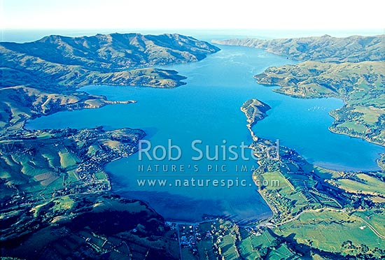 Looking down Akaroa Harbour. Onawe Peninsula centre. Akaroa top left, Duvauchelle bottom centre, Banks Peninsula, Christchurch City District, Canterbury Region, New Zealand (NZ) stock photo.