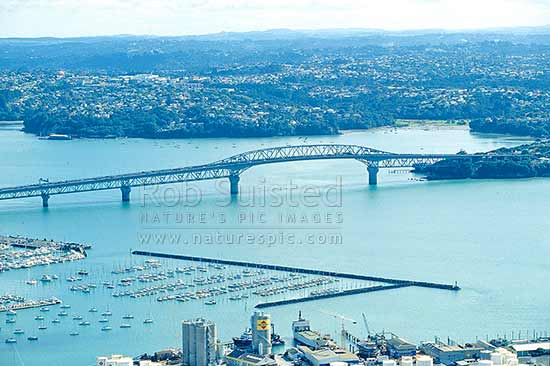 Auckland Harbour Bridge over the Waitemata Harbour. Northcote and Birkenhead beyond, Auckland, Auckland City District, Auckland Region, New Zealand (NZ) stock photo.