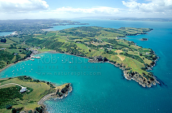 Overlooking Matiatia Bay and Ferry terminal on Western Waiheke Island, Hauraki Gulf. Boats moored at the bay, Waiheke Island, Auckland City District, Auckland Region, New Zealand (NZ) stock photo.