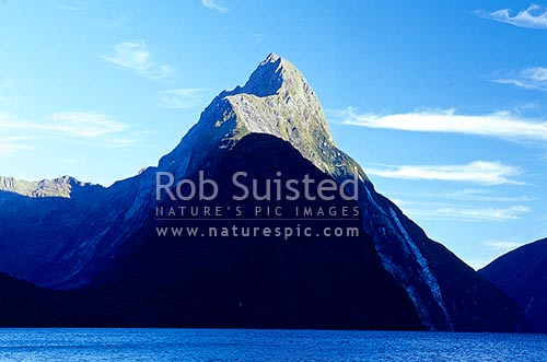 Mitre Peak (1683m) in Milford Sound fiord, Fiordland National Park, Southland District, Southland Region, New Zealand (NZ) stock photo.