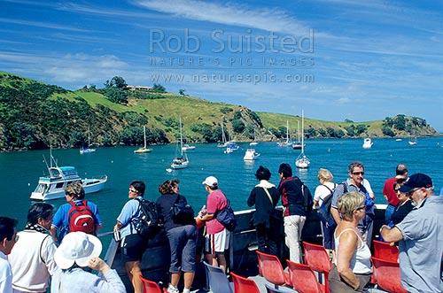 Ferry passengers and yachts moored in Matiatia Bay, Waiheke Island, Auckland City District, Auckland Region, New Zealand (NZ) stock photo.