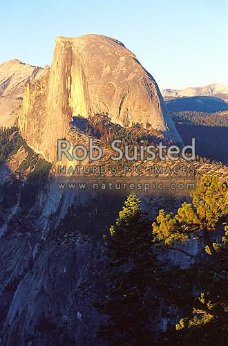 Half Dome (8836ft) in Yosemite National Park at sunset. Cloud's Rest behind. Viewed from Glacier Point, Yosemite National Park, USA, California District, California Region, United States of America stock photo.