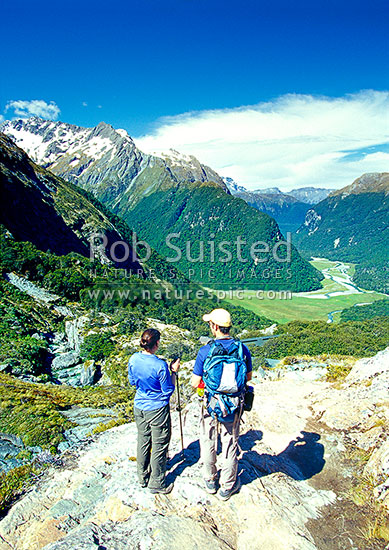 Trampers at Routeburn Falls Hut above the Routeburn Flats, Routeburn Track Great Walk, Mount Aspiring National Park, Queenstown Lakes District, Otago Region, New Zealand (NZ) stock photo.