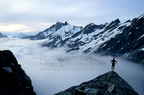 Mountaineer climbing Dilemma Peak (2594m), Main Divide. Bivvy. PHOTO BY: Phil Suisted, Aoraki / Mount Cook National Park, MacKenzie District, Canterbury Region, New Zealand (NZ) stock photo.