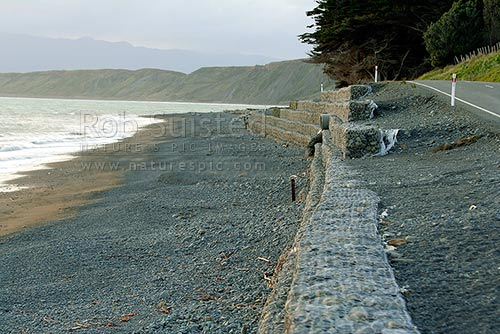 Coastal erosion control work on the foreshore at Te Kopi, protecting the road, Te kopi, South Wairarapa District, Wellington Region, New Zealand (NZ) stock photo.