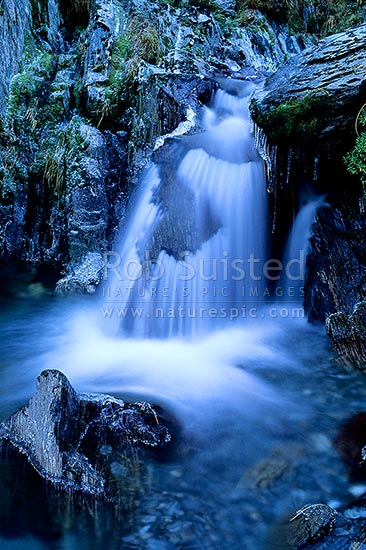 Small waterfall and icicles in alpine Dale creek, Mt Adams, Westland, Westland District, West Coast Region, New Zealand (NZ) stock photo.
