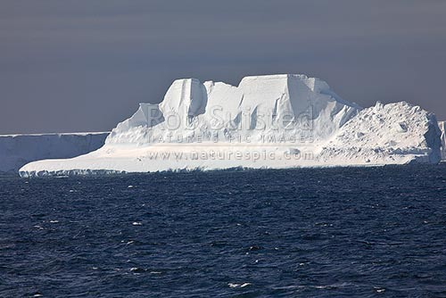 Grounded and eroded tabular icebergs, Cape Adare, Ross Sea, Antarctica District, Antarctica Region, Antarctica stock photo.