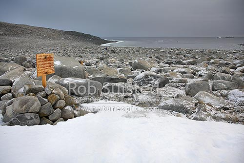 Inexpressible Island, taken from the site of Campbell's historic 1912 ice cave, Evan's Cove, Terra Nova Bay, Cairn and sign marking site, Ross Sea, Antarctica District, Antarctica Region, Antarctica stock photo.