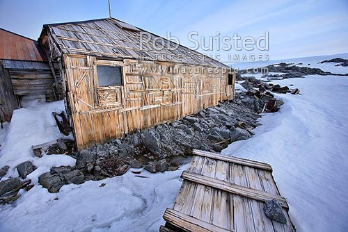 The Historic 1912-14 Mawson's hut and artefact scatter, Cape Denison -'Home of the Blizzard', Commonwealth Bay, George V Land, Antarctica District, Antarctica Region, Antarctica stock photo.