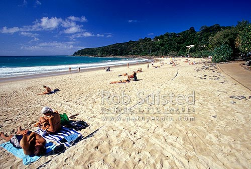 People enjoying the sun on Noosa Beach, Noosa, QLD, Queensland District, Australia stock photo.