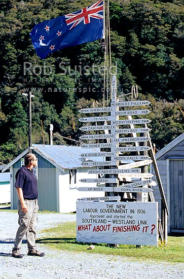 Signpost at Gunns Camp in the Hollyford Valley, Fiordland National Park, Southland District, Southland Region, New Zealand (NZ) stock photo.
