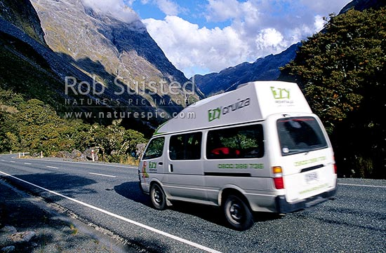 Campervan or motorhome on the Milford - Te Anau Road. Upper Hollyford valley. State Highway 94, Fiordland National Park, Southland District, Southland Region, New Zealand (NZ) stock photo.