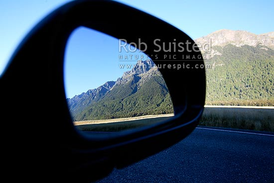 View in the rear view mirror of a car, Fiordland National Park, Te Anau, Invercargill District, Southland Region, New Zealand (NZ) stock photo.
