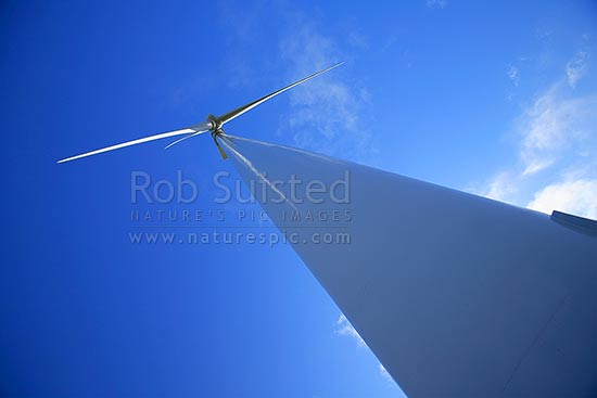 Giant Te Apiti wind farm Vestas turbines over farmland (towers 70m high, 35m blades, 1.65MW), Ashhurst, Manawatu District, Manawatu-Wanganui Region, New Zealand (NZ) stock photo.