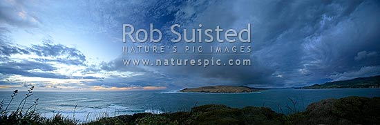 Moody stormy evening skies over the Hokianga Harbour Entrance and North Head from the Arai te Uru Heritage Walk. Omapere and Opononi right. Panoramic view, Omapere, Hokianga, Far North District, Northland Region, New Zealand (NZ) stock photo.