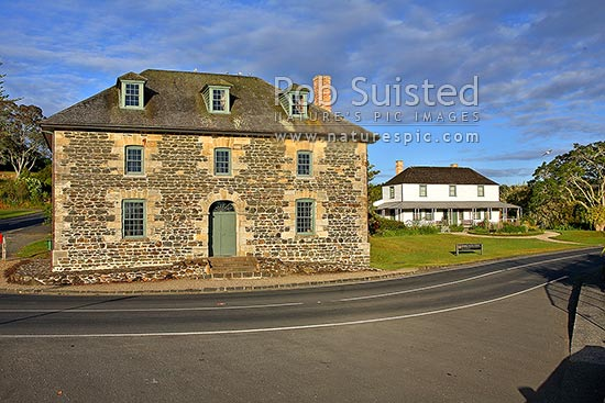 Historic Stone Store (1832) and Mission Station Kemp House (1821-right). Early morning, Kerikeri Inlet Basin and river, Kerikeri, Far North District, Northland Region, New Zealand (NZ) stock photo.