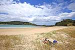 Sunbather on beach, Northland