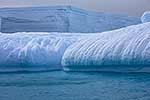 Rolled and striated icebergs