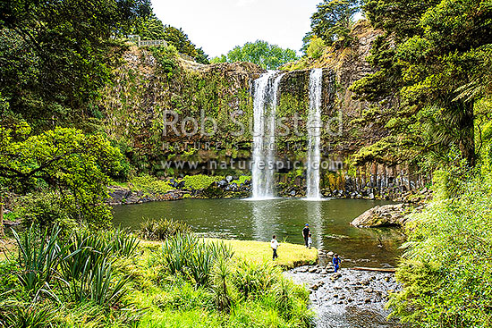 Family enjoying Whangarei Falls, a 25 metre waterfall on the Hatea River, scenic reserve, Whangarei, Far North District, Northland Region, New Zealand (NZ) stock photo.