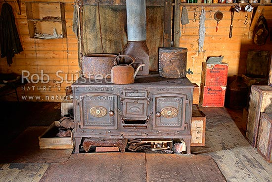 Interior of Ernest Shackleton's British Antarctic (Nimrod 1907-09) Expedition hut with Smith and Wellstood Columbian Stove, Cape Royds, Ross Island, Antarctica stock photo.
