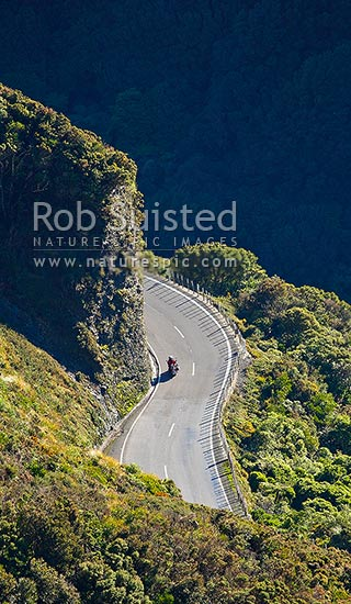 Motorcycle on the Remutaka (Rimutaka) Hill Road climbing to the 555m summit linkng Wellington and the Wairarapa (State Highway 2), Remutaka, Upper Hutt City District, Wellington Region, New Zealand (NZ) stock photo.