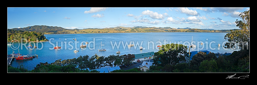 Image of Panoramic view over Mangonui township on White Point, Mangonui wharf, and fishing vessels, boats and yachts moored in harbour, Mangonui, Far North District, Northland Region, New Zealand (NZ) stock photo image