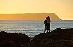 Young couple hugging on coast