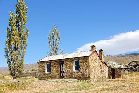 Historic Mitchell's stone cottage, erected by John Mitchell (completed 1904) from Shetland Islands during goldmining era. Historic Reserve, Fruitlands, Central Otago District, Otago Region, New Zealand (NZ) stock photo.