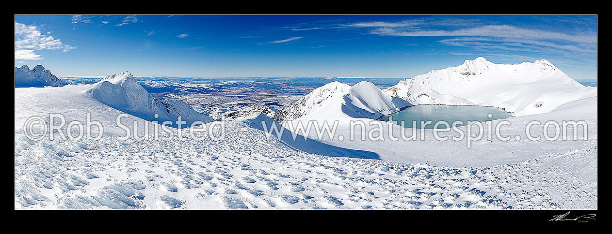 Image of Mount Ruapehu summit plateau (left) and Crater Lake below the summit (Tahurangi 2797m). Wind blown sculptured ice formations and textures. Panorama, Tongariro National Park, Ruapehu District, Manawatu-Wanganui Region, New Zealand (NZ) stock photo image