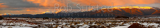Kaimanawa Ranges with winter evening light at sunset. Looking across the Rangipo Desert in snow to the Kaimanawa Mountains Ranges. Panorama, Kaimanawa Forest Park, Taupo District, Waikato Region, New Zealand (NZ) stock photo.