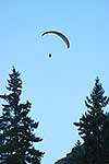 Person paragliding above Queenstown
