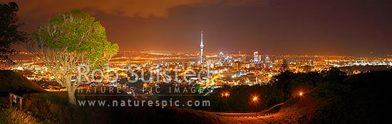 Auckland City night time panorama from Mount Albert, with Sky Tower, CDB buildings and Harbour Bridge visible, Auckland City, Auckland City District, Auckland Region, New Zealand (NZ) stock photo.