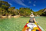 Tourist sea kayaking along coast