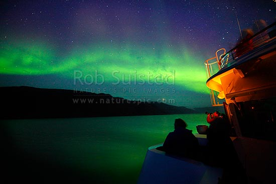 The Northern Lights (Aurora borealis) playing above the ship's bridge. Kangerlussuaq Fiord. Silversea, Prince Albert II, Kangerlussuaq, Greenland stock photo.