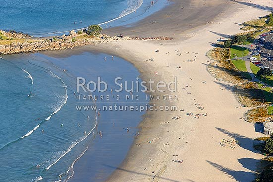 Mount Maunganui beach with people enjoying summertime on Marine Parade. Aerial view, Mount Maunganui, Tauranga District, Bay of Plenty Region, New Zealand (NZ) stock photo.