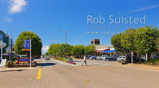 Te Anau township main street on summer day, Te Anau, Southland District, Southland Region, New Zealand (NZ) stock photo.
