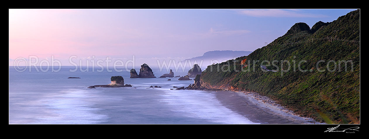 Image of Rugged West Coast coastline near Motukiekie Rocks (Ten Mile Creek / Waianiwaniwa) at sunset. Paparoa Ranges beyond, Rapahoe, Grey District, West Coast Region, New Zealand (NZ) stock photo image