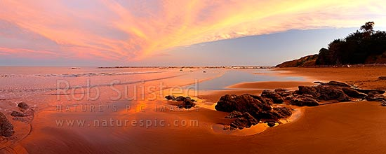 Port Awanui sunset panorama at beach near East Cape, East Coast, Port Awanui, East Coast, Gisborne District, Gisborne Region, New Zealand (NZ) stock photo.