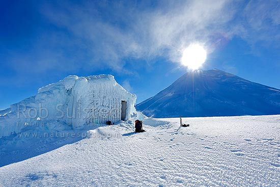 Syme Hut on Fantham's Peak (Panitahi# at 1962 m, on Mt Taranaki #above), encrusted with winter ice, Egmont National Park, Taranaki, Stratford District, Taranaki Region, New Zealand (NZ) stock photo.