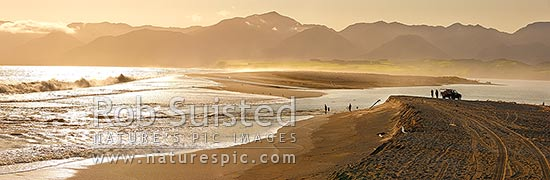 Lake Onoke entrance and Ruamahanga River mouth in Palliser Bay with fishermen and whitebaiters in evening. Remutaka (Rimutaka) Ranges beyond. Panorama, Lake Ferry, South Wairarapa District, Wellington Region, New Zealand (NZ) stock photo.