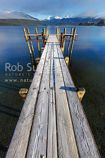 Lake Te Anau jetty on a calm frosty morning in winter, Te Anau, Southland District, Southland Region, New Zealand (NZ) stock photo.